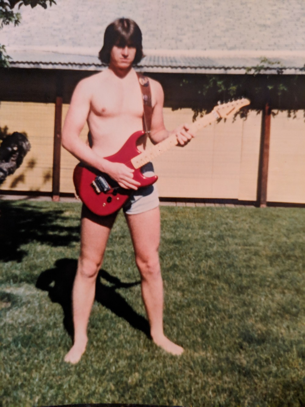 19 Years old shirtless with Kramer Pacer in backyard in Corvallis